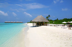 Maldives, ocean landscape. Beach bar and bungalows in the lagoon, Maldives Stock Image