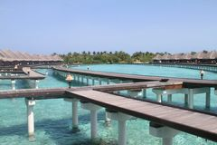 Maldives Overwater Bungalows. Photo showing some overwater bungalows on Embudhoo Finolhu island - South Male Atoll - Maldives stock image