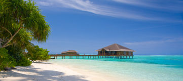 Maldives Panorama. Medhufushi Island of Maldives with blue lagoon and water bungalows Stock Images