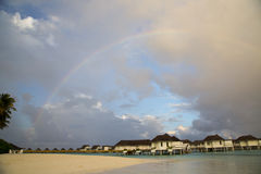Maldives rainbow. A rainbow above Maldives water villa Royalty Free Stock Images