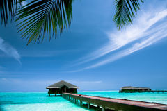 Maldives Resort. Medhufushi Island of Maldives with blue lagoon and water bungalows Stock Images