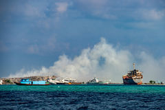 Maldives rubbish island garbage in flames Royalty Free Stock Photos
