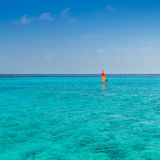 Maldives. Sailing boat with orange, red sail on the ocean Royalty Free Stock Images