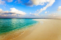 Maldives.A sandy beach and an ocean coast Royalty Free Stock Photo