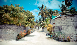 Maldives scenes. A road in a village in the Maldives Royalty Free Stock Images