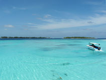 Maldives sea. Clear sky and clear sea with speed boat Stock Photo