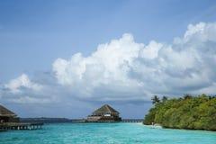 Ocean, palms and villas. Maldives sea, clouds, palms and villas Stock Photos