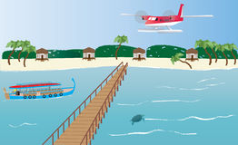 Maldives Seaplane. A Floatplane landing at an Island in the Maldives with a Dhoni boat,bungalows and a Jetty Stock Photography
