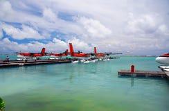 Maldives. A seaplane at a mooring at ocean. Royalty Free Stock Photo