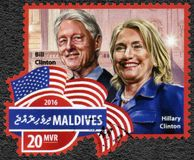 MALDIVES - 2016: shows William Jefferson Clinton born 1946 42nd President of the United States, and Hillary Clinton born 1947. MALDIVES - CIRCA 2016: A stamp royalty free stock photography