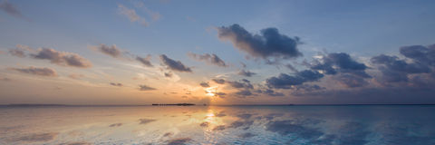 Maldives sunrise, the reflection in sea ia amazing. Stock Image