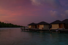 Maldives sunset beach, water villa resort Royalty Free Stock Images