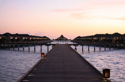 MALDIVES SUNSET. WATER BUNGALOW Royalty Free Stock Photos
