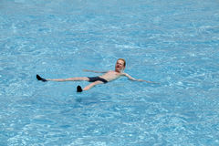 Maldives. Teenager has a rest on turquoise transparent water of ocean Stock Photo