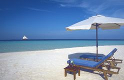 Maldives tropical beach and Sun loungers Stock Photos