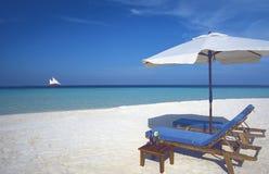 Maldives tropical beach and Sun loungers. Sun loungers and tropical beach in Maldives, Indian ocean stock photos