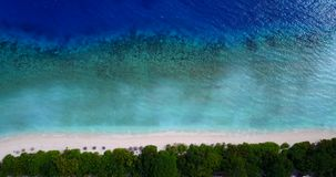 V08704 maldives tropical island and blue sea with drone aerial flying view on a beach with white sand and beautiful sky
