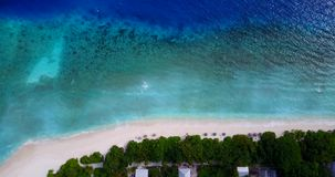 V08713 maldives tropical island and blue sea with drone aerial flying view on a beach with white sand and beautiful sky. Maldives tropical island and blue sea stock video