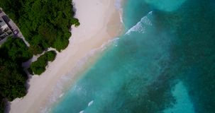 V08956 maldives tropical island and blue sea with drone aerial flying view on a beach with white sand and beautiful sky. Maldives tropical island and blue sea stock video