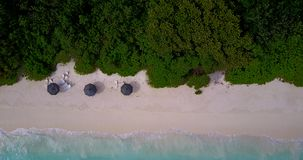 V08604 maldives tropical island and blue sea with drone aerial flying view on a beach with white sand and beautiful sky. Maldives tropical island and blue sea stock video