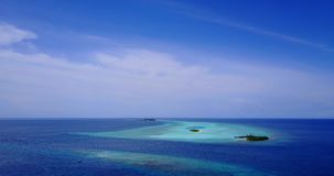 V08741 maldives tropical island and blue sea with drone aerial flying view on a beach with white sand and beautiful sky. Maldives tropical island and blue sea stock video footage