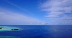 V08735 maldives tropical island and blue sea with drone aerial flying view on a beach with white sand and beautiful sky. Maldives tropical island and blue sea stock video