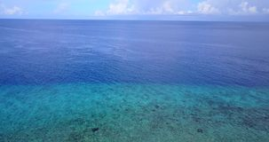 V08650 maldives tropical island and blue sea with drone aerial flying view on a beach with white sand and beautiful sky. Maldives tropical island and blue sea stock footage