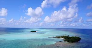 V08817 maldives tropical island and blue sea with drone aerial flying view on a beach with white sand and beautiful sky. Maldives tropical island and blue sea stock footage