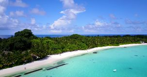 V08688 maldives tropical island and blue sea with drone aerial flying view on a beach with white sand and beautiful sky. Maldives tropical island and blue sea stock video