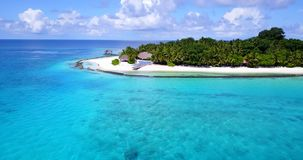 V08951 maldives tropical island and blue sea with drone aerial flying view on a beach with white sand and beautiful sky. Maldives tropical island and blue sea stock footage
