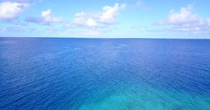 V08776 maldives tropical island and blue sea with drone aerial flying view on a beach with white sand and beautiful sky. Maldives tropical island and blue sea stock footage