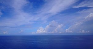 V08687 maldives tropical island and blue sea with drone aerial flying view on a beach with white sand and beautiful sky. Maldives tropical island and blue sea stock video footage