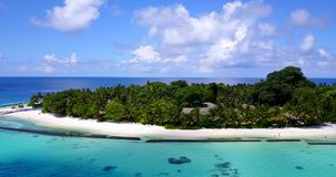 V08707 maldives tropical island and blue sea with drone aerial flying view on a beach with white sand and beautiful sky. Maldives tropical island and blue sea stock video footage