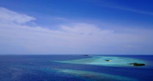 V08743 maldives tropical island and blue sea with drone aerial flying view on a beach with white sand and beautiful sky. Maldives tropical island and blue sea stock video footage