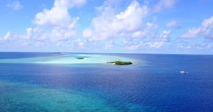 V08812 maldives tropical island and blue sea with drone aerial flying view on a beach with white sand and beautiful sky. Maldives tropical island and blue sea stock video footage
