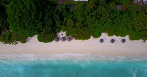 V08996 maldives tropical island and blue sea with drone aerial flying view on a beach with white sand and beautiful sky. Maldives tropical island and blue sea stock footage