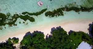 V08614 maldives tropical island and blue sea with drone aerial flying view on a beach with white sand and beautiful sky. Maldives tropical island and blue sea stock video footage