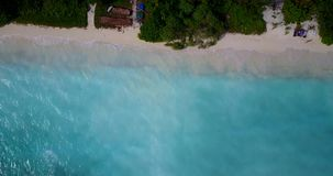 V08763 maldives tropical island and blue sea with drone aerial flying view on a beach with white sand and beautiful sky. Maldives tropical island and blue sea stock footage