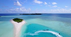 V08872 maldives tropical island and blue sea with drone aerial flying view on a beach with white sand and beautiful sky. Maldives tropical island and blue sea stock video