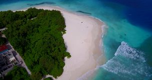 V08600 maldives tropical island and blue sea with drone aerial flying view on a beach with white sand and beautiful sky stock video footage