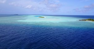 V08732 maldives tropical island and blue sea with drone aerial flying view on a beach with white sand and beautiful sky stock footage