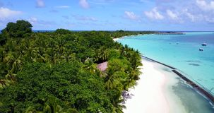 V08601 maldives tropical island and blue sea with drone aerial flying view on a beach with white sand and beautiful sky. Maldives tropical island and blue sea stock footage