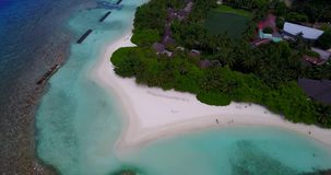 V08998 maldives tropical island and blue sea with drone aerial flying view on a beach with white sand and beautiful sky stock footage