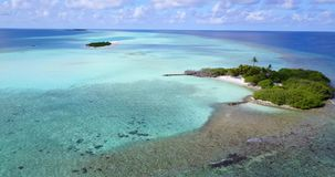 V08824 maldives tropical island and blue sea with drone aerial flying view on a beach with white sand and beautiful sky stock video