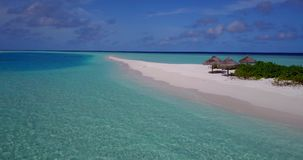V08625 maldives tropical island and blue sea with drone aerial flying view on a beach with white sand and beautiful sky. Maldives tropical island and blue sea stock video