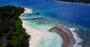V08974 maldives tropical island and blue sea with drone aerial flying view on a beach with white sand and beautiful sky stock footage