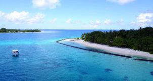 V08657 maldives tropical island and blue sea with drone aerial flying view on a beach with white sand and beautiful sky. Maldives tropical island and blue sea stock image