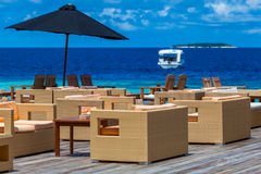 Maldives, tropical paradise, bar with pieces of furniture Stock Images