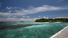 Maldives, a view from the bridge to the island stock footage