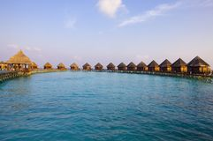 Maldives.   Villa on piles on water at the time su Royalty Free Stock Images